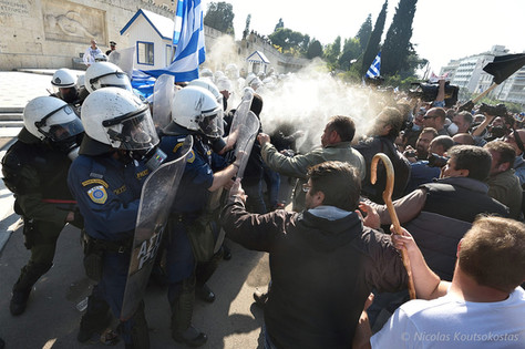 Clashes between riot police and farmers in Athens
