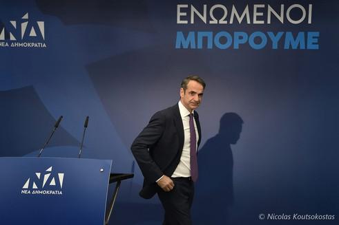 Kyriakos Mitsotakis talks to the press in Athens