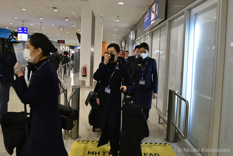 Passengers from Beijing arrive at Athens airport