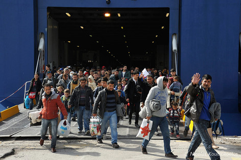 Refugees and migrants disembark at the Port of Piraeus