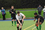 Witney Hockey mens player dribbling with the ball