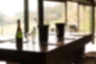 Tom Goldsmith Joinery - Bespoke Table with Crown Cut Oak Veneer, Anodised Footrails and Lockable Wheels