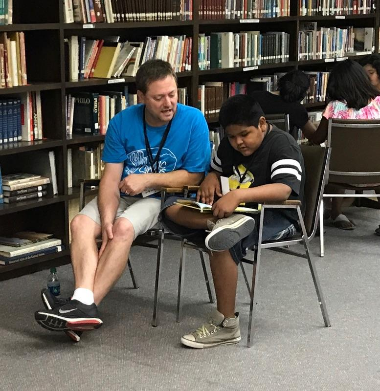 Reading to camper