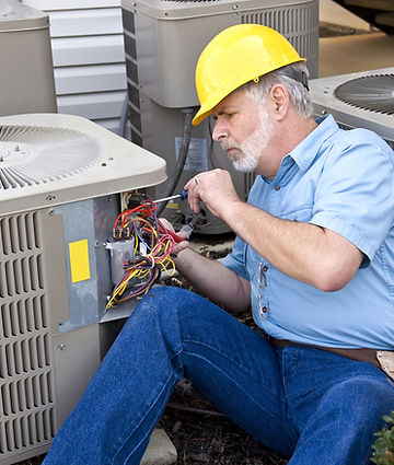technician repairing residential air conditioning system
