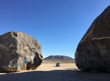 Truck between rocks.png