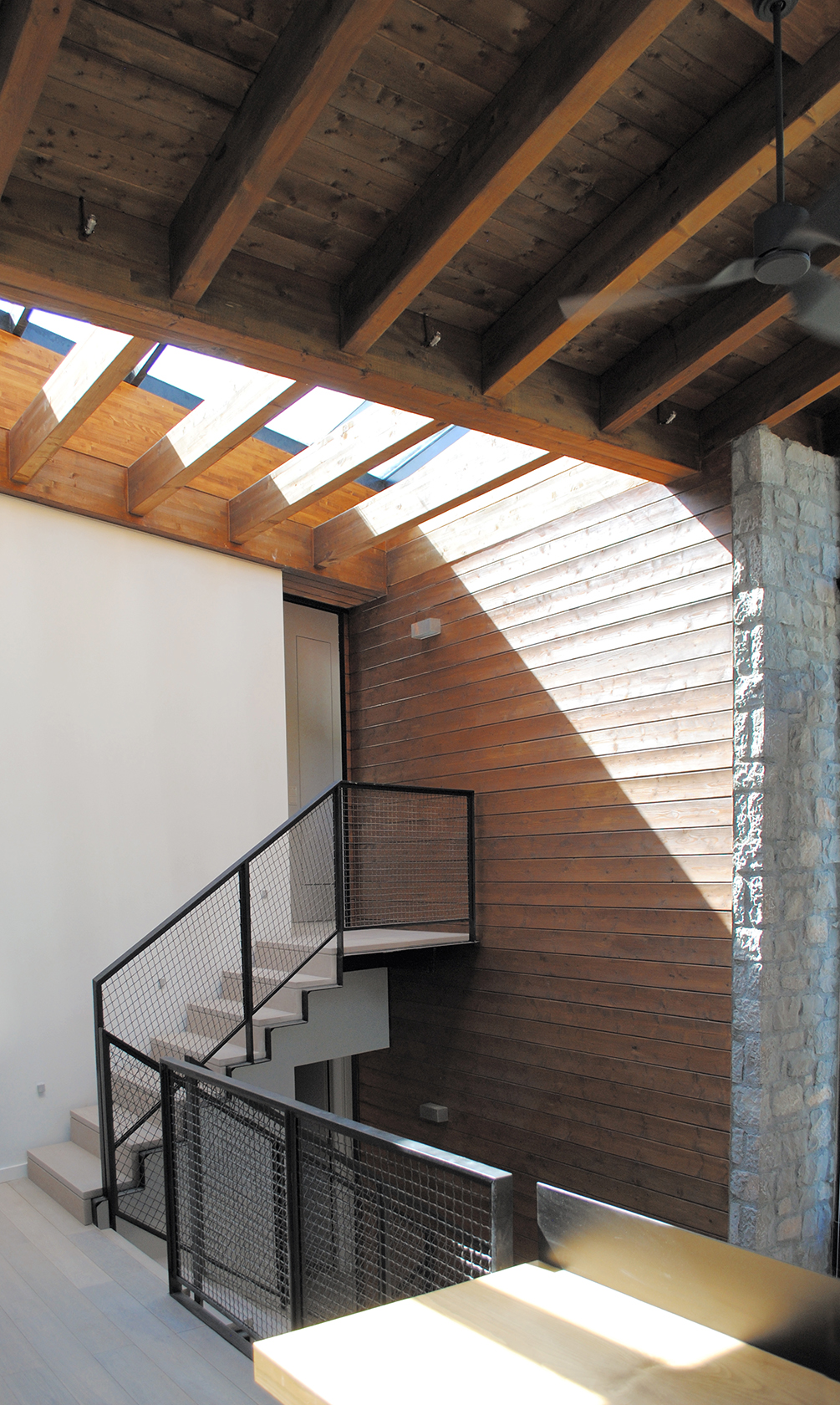 Wedge stairway with natural light