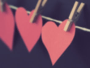 photo-of-red-heart-shaped-paper-hanging-