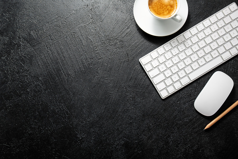 Image of keyboard and coffee with black background