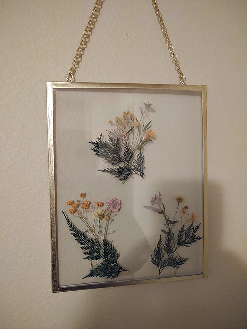 Floating frame with dried flowers