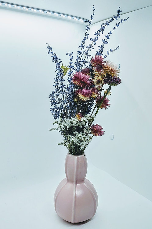 Small flowers in pink vase