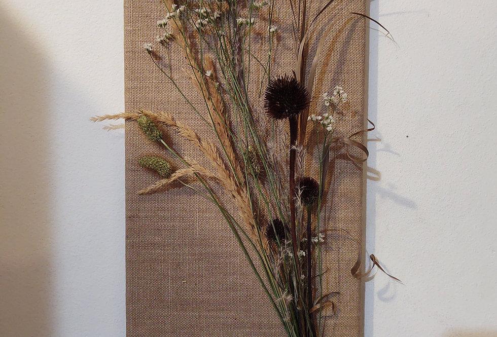 Dried arrangement on burlap board