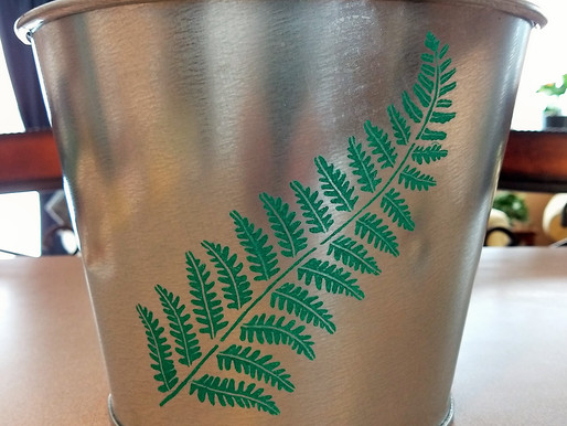 Spruce up your metal containers with stencils.