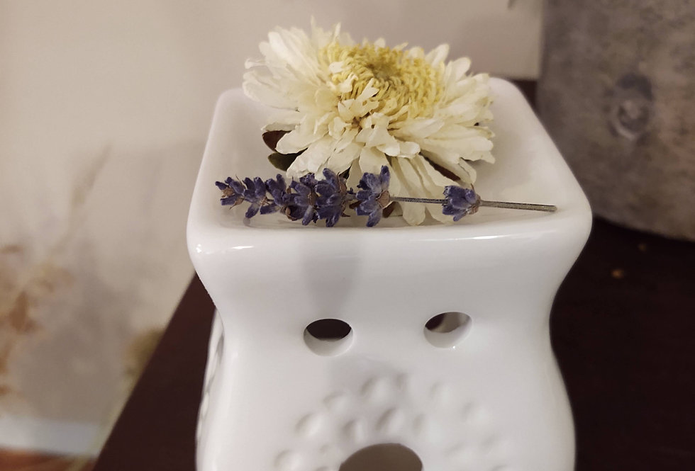 Candle holder with flowers