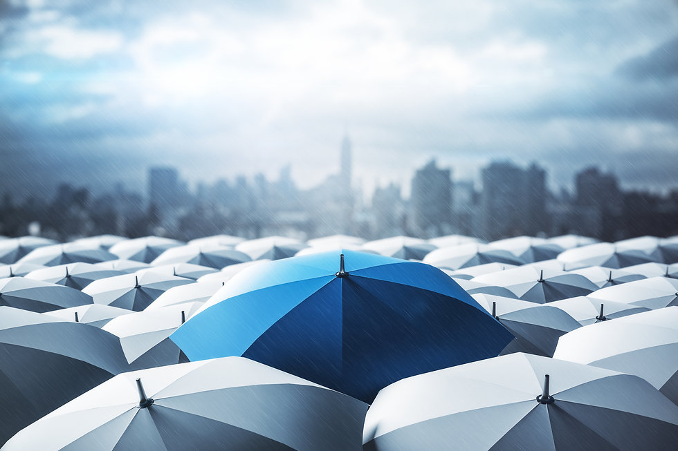 Blue umbrella on top of other gray umbrellas on city background. Business and safety conce