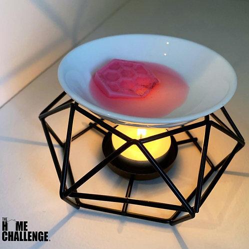 Asymmetric wax melt burner