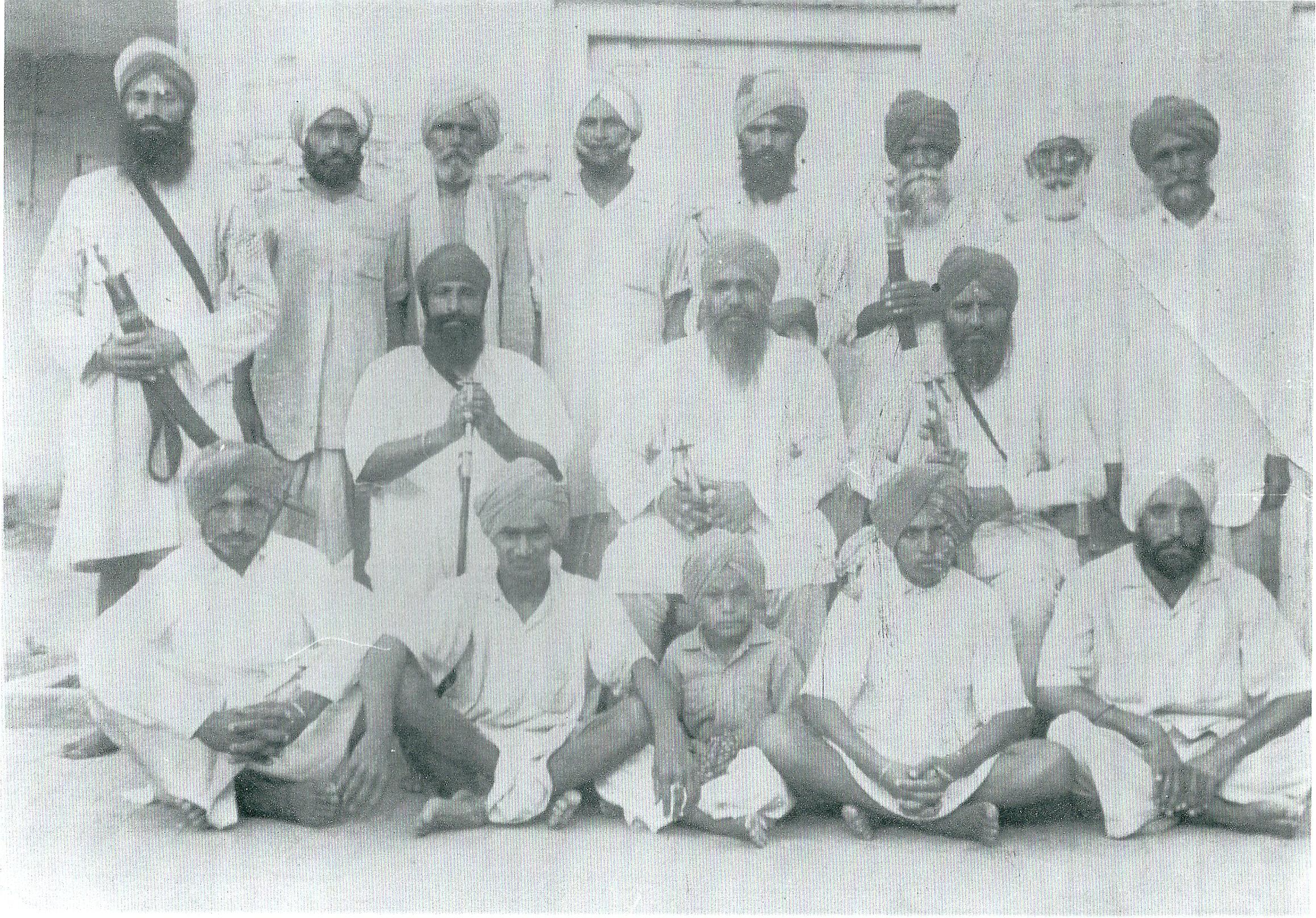 J Mohan Singh - center
