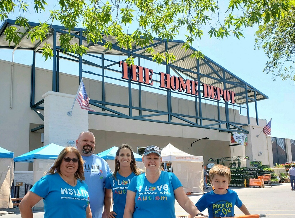 Home Depot employees Yvonne Avina, far left, Mike Myer, store manager, Natalie Hernandez, Valerie Miguel and Miguel's grandson Isaiah show off the T-shirts they sold to help raise money for UCPCC.