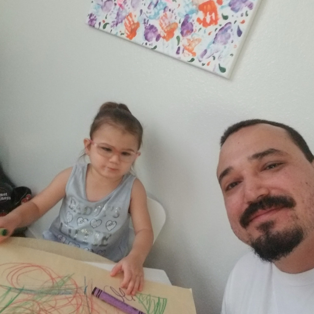 Gracie and her dad, Jose Rocha, work on an art project.