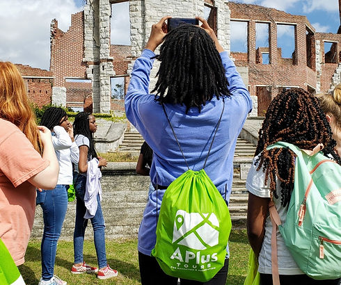 Girl Taking Photo of Ruins with Drawstring Backpack On_edited_edited_edited.jpg