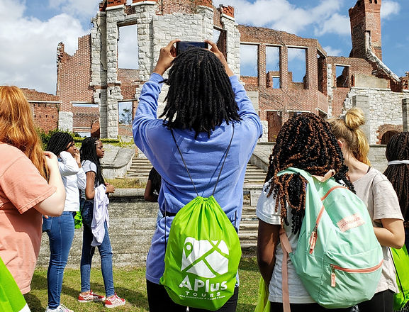 Girl Taking Photo of Ruins with Drawstring Backpack On_edited_edited.jpg