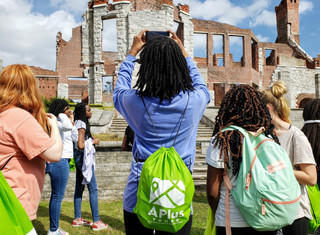 Girl Taking Photo of Ruins with Drawstring Backpack On_edited.jpg