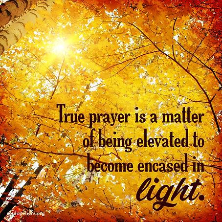 Prayer is becoming encased in light.