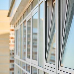 pvc-windows-on-facade-of-skyscraper-plastic-double-BJGZD33.jpg