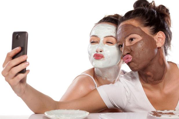Girl-doing-facial-mask-selfie-Stock-Phot