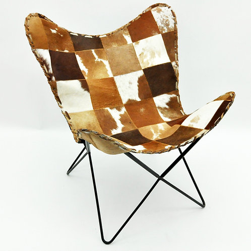 TAN AND WHITE COW-HIDE BUTTERFLY CHAIR