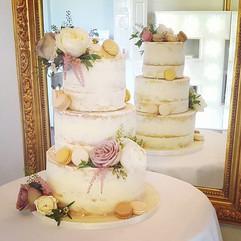 Semi naked wedding cake with fresh flowe