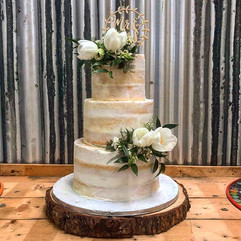 The semi naked wedding cake is still jus