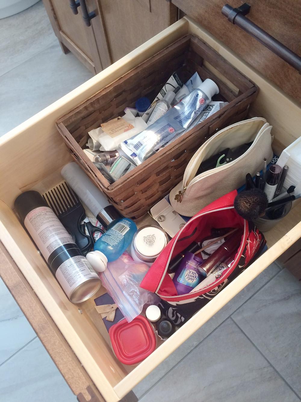 unorganized cosmetics drawer