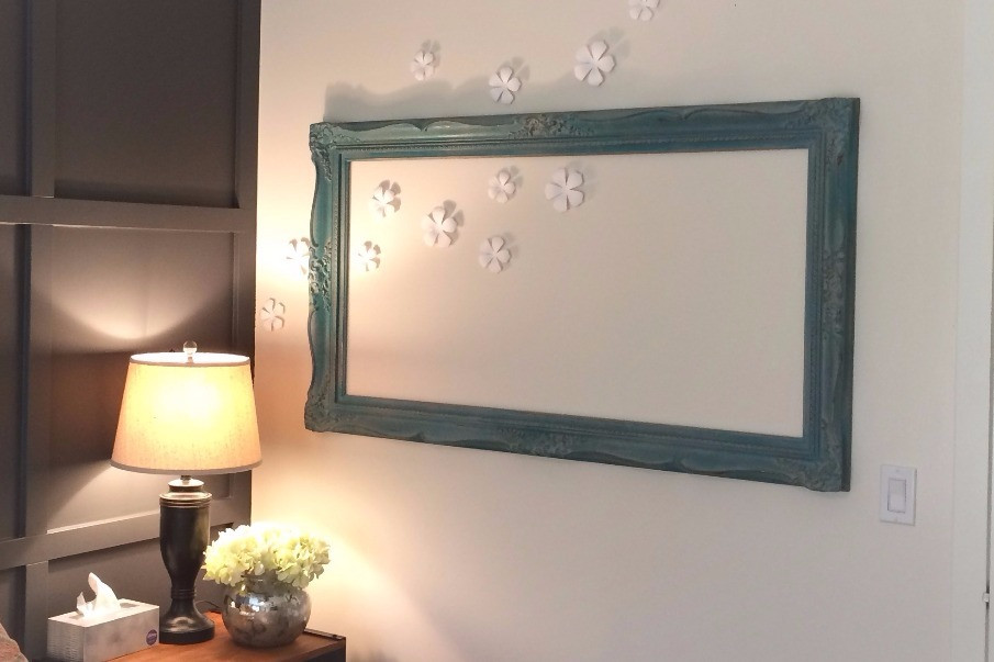 Empty picture frame with wall flowers