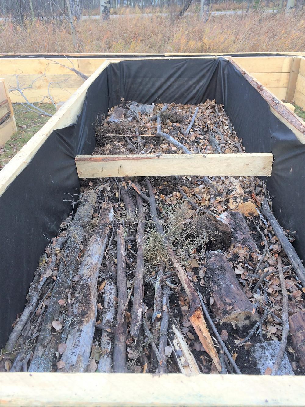 layering a hugelkultur bed