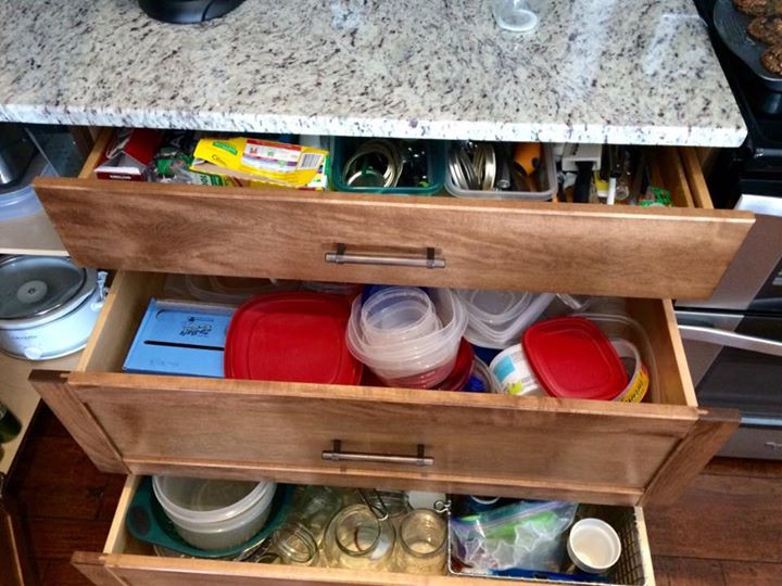 unorganized Tupperware drawer