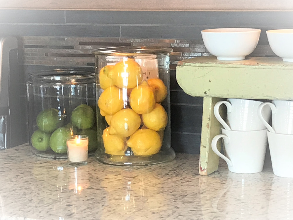 Glass jars of lemons and limes add a touch of spring Hygge
