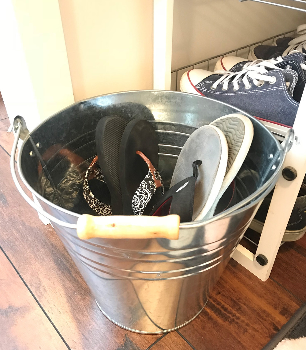 use a galvanized bucket for flip-flops