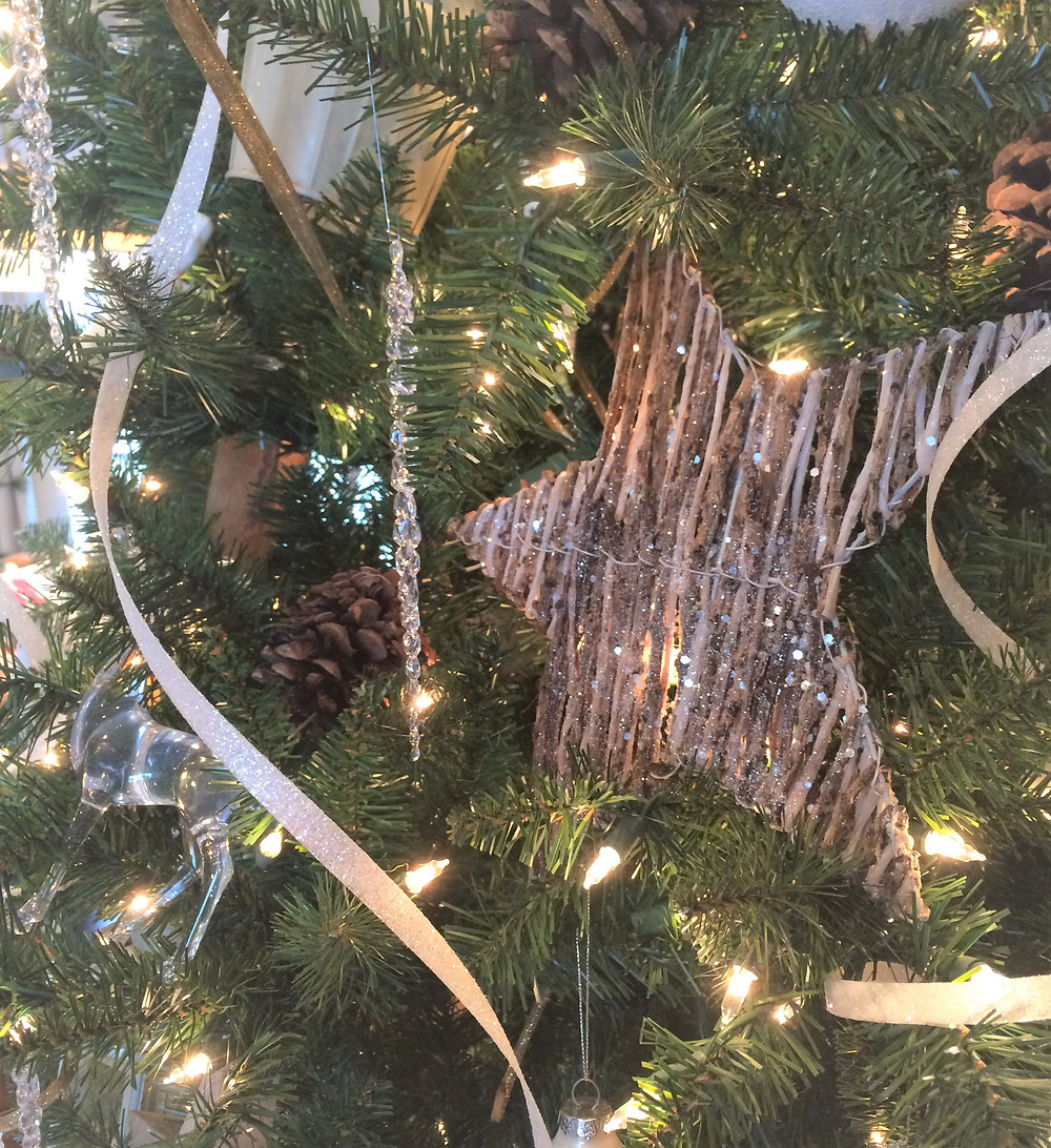 twig and glitter star on a Christmas tree