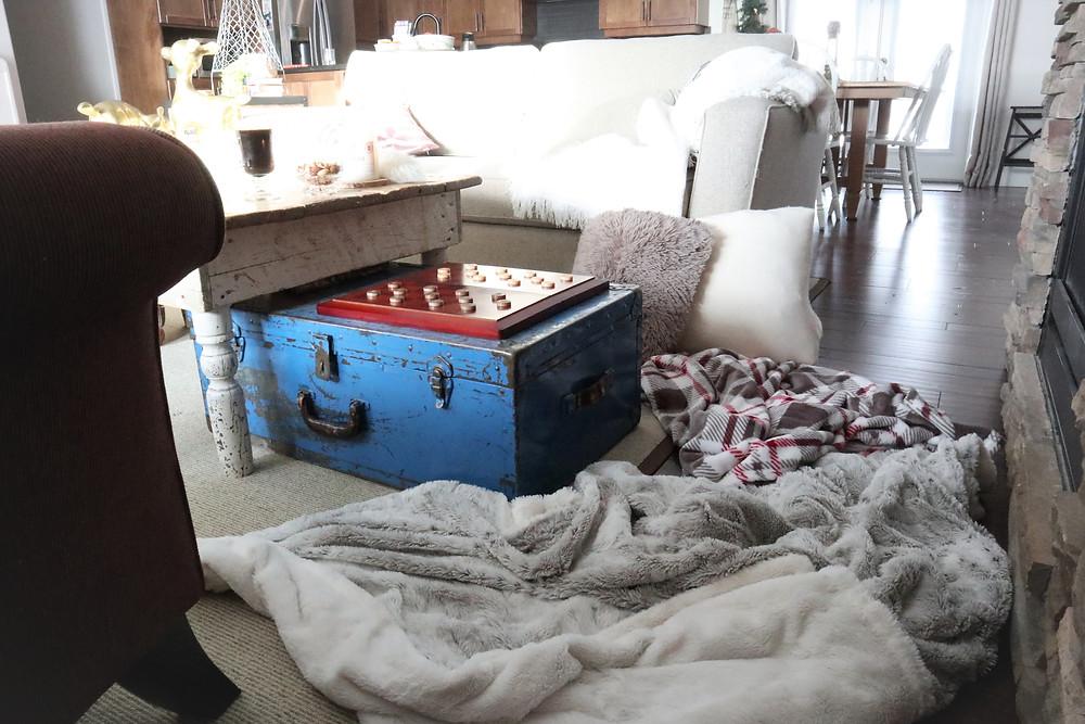 cozy blankets, coffee, throw pillows