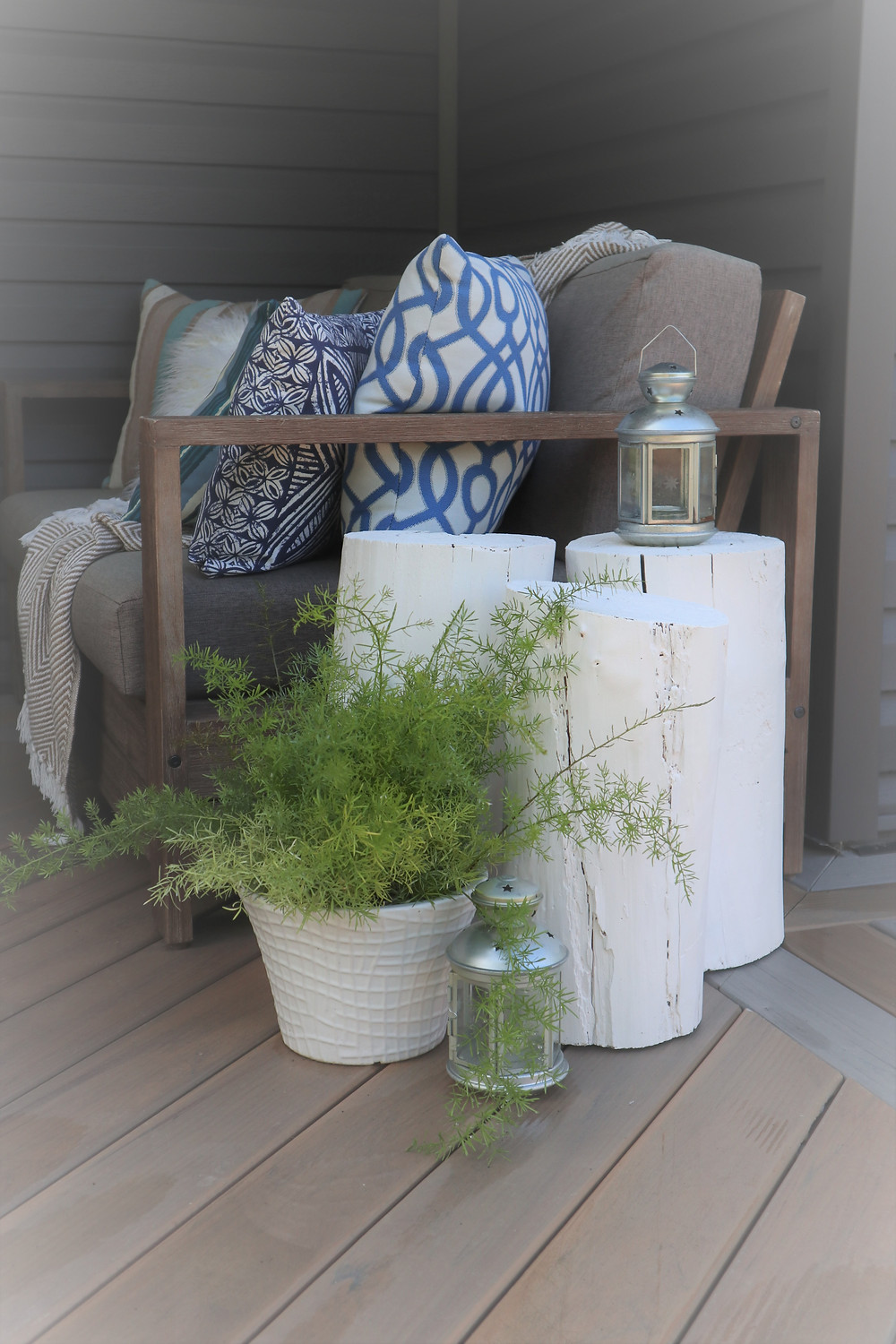 white painted stumps as side tables, hygge decor