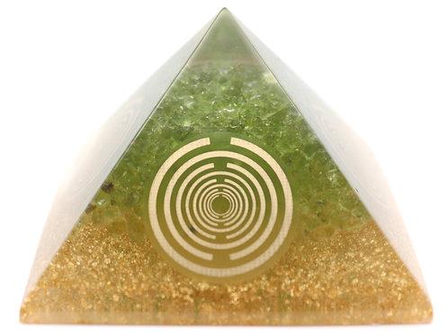 Orgone pyramid with peridot crystals