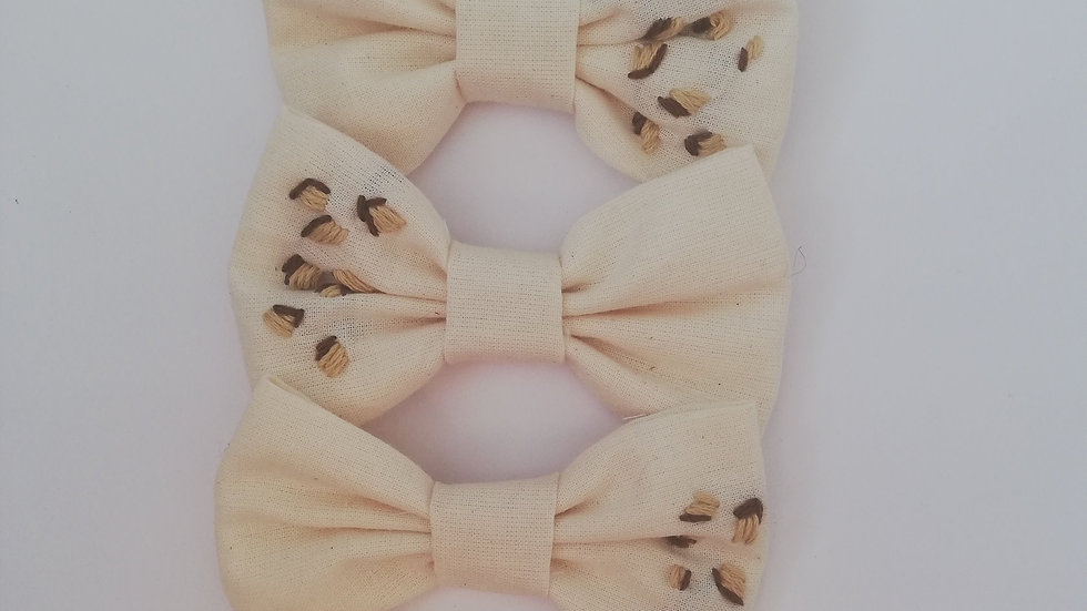 hand embroidered leopard bow