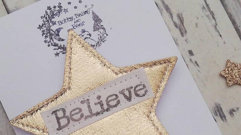 believe badge