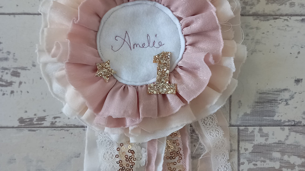 Blush and ivory birthday rosette with embroidered name and glitter age