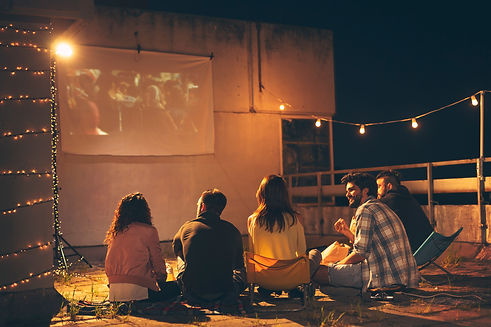 Group of young friends watching a movie