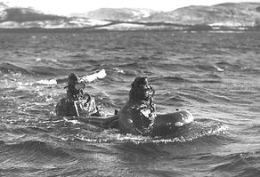 "Two charioteers astride their ""human torpedo"" at Loch Erisort in Scotland, 1942."