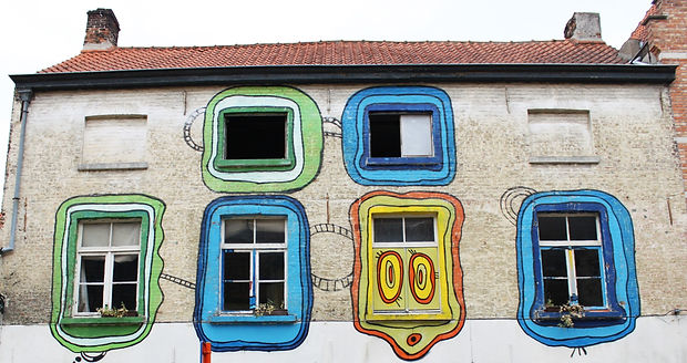 Colourful windows with street art in Brugge, Bruges, Belgium. © Kriti Bajaj