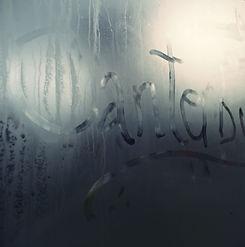 Canterbury written by hand on a misted bus window en route to Kent. © Kriti Bajaj