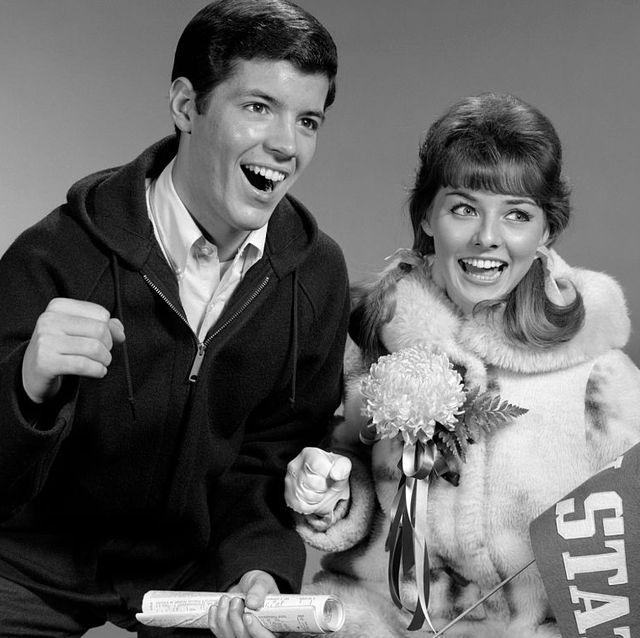 1960s-portrait-of-college-couple-at-autu