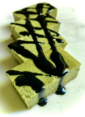 Matcha green tea tofu cake with black tahini sauce